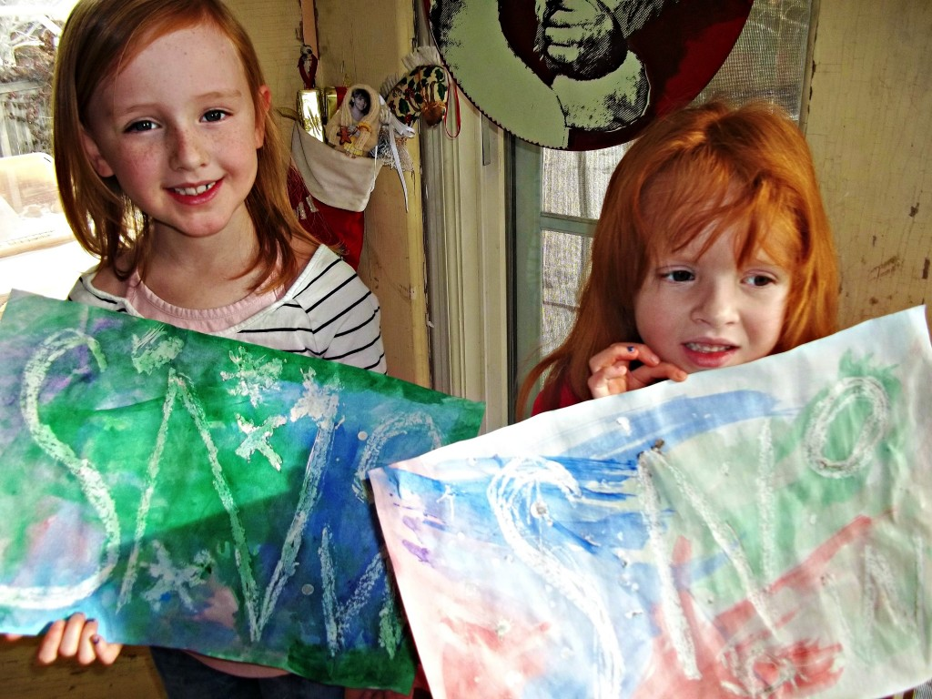 gemma and guini with their relief paintings