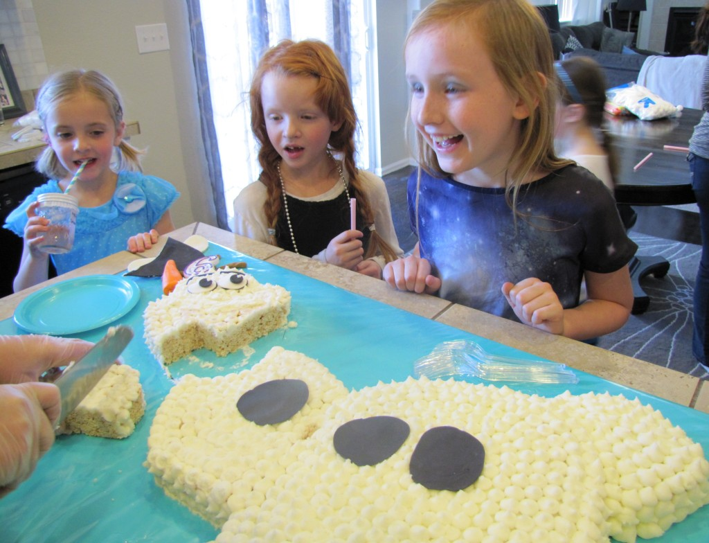 cutting the olaf cake